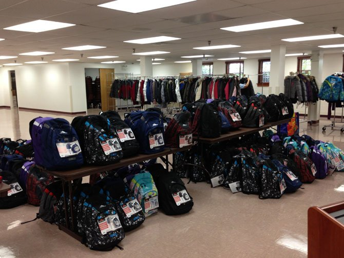 Donated items include backpacks, clothes and school supplies.
