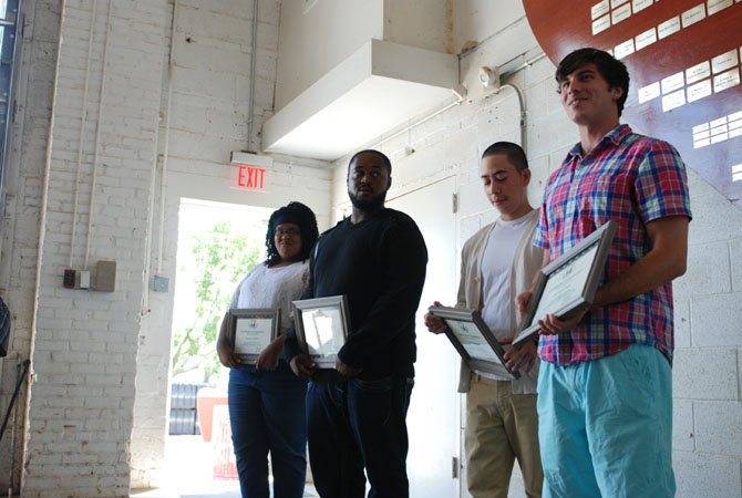 Families and friends celebrate as apprentice of 10 months Nashell Dennis , apprentice of  4 months Coby Stewart, apprentice of 8 months Juan Carlos Henriquez and apprentice of 5 and a half months Anthony Ness receive their certificates during the apprentices graduation ceremony at the Alexandria Seaport Foundation on July 26.