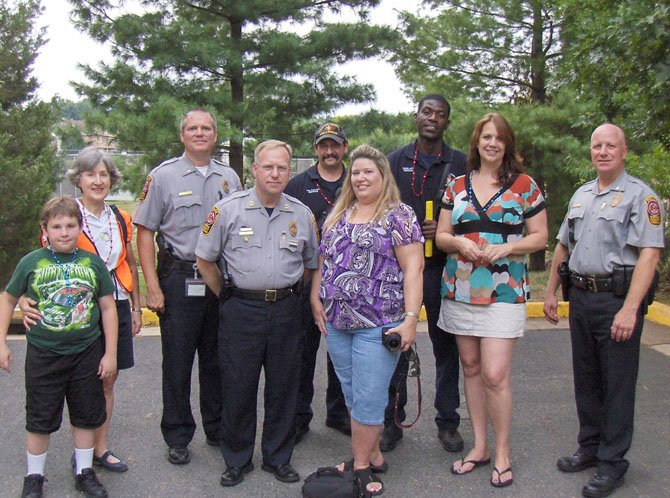 Enjoying National Night Out in Sully Station II in August 2011 are (front row, from left) Jesse and Rose Plowchin, Lt. John Trace and Capt. Purvis Dawson of the Sully District Station, Kim Hines, Laura Elder and then Deputy Chief of Patrol E.C. Roessler; and (back row, from left) Paul Fraraccio and Eugene Larty of West Centreville Fire Station 38.