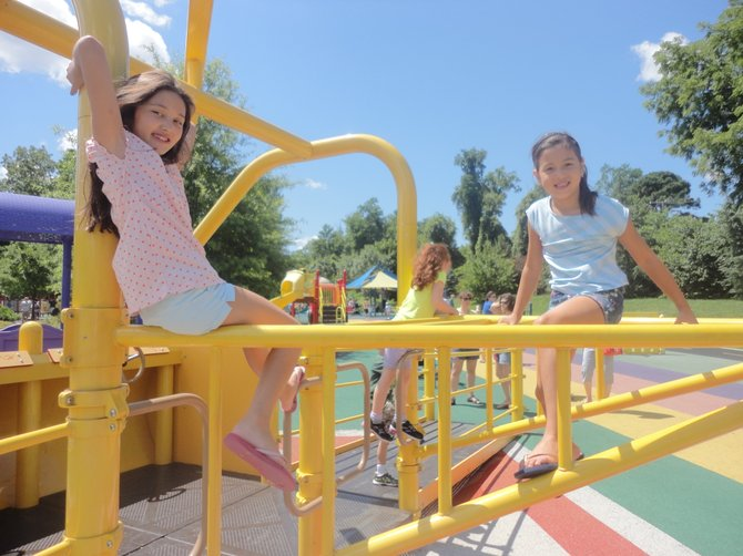 Sisters Charlotte, 8, and Scarlet Steuble, 7, enjoy one of Clemynjontri Park's many amusements on Sunday, Aug. 4.