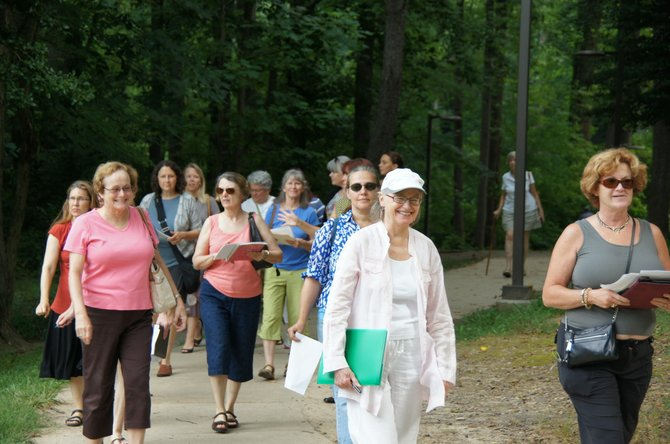 A group of MPAartfest artists stroll through McLean Central Park as part of their MPAartfest artist orientation.