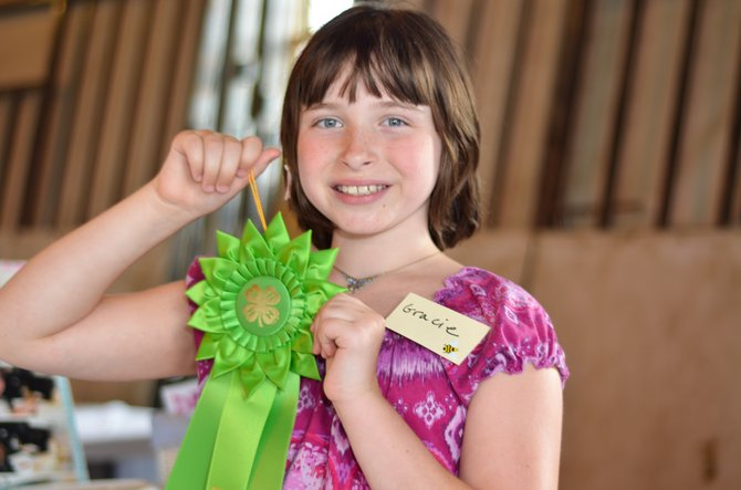 Gracie Meade, first place winner in the 4-H competition for Honey Bees and other Apiary Products.