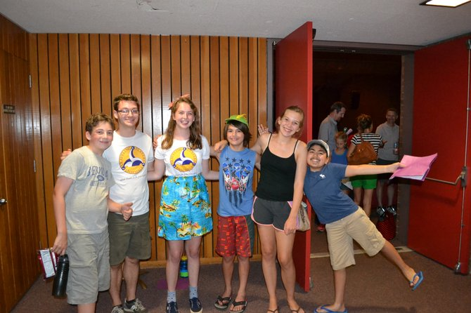 Cast and crew of the Traveling Players Middle School Ensemble Henry Hoagland, assistant director, Patrick Smith, assistant director, Ellie Robb, Clarke Paty, Emma Flye and Soven Bhagat, celebrate after the production.