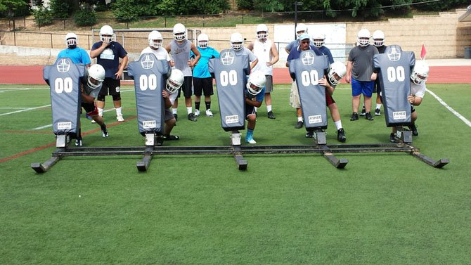 Yorktown linemen go through a sled drill at practice.