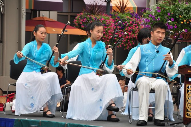 Erhu players with the Shanghai Yangpu Youth Palace student troupe perform at Reston Town Center Saturday, Aug. 10.