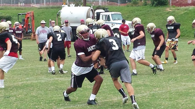 The Oakton football team opens its season against T.C. Williams on Aug. 30.