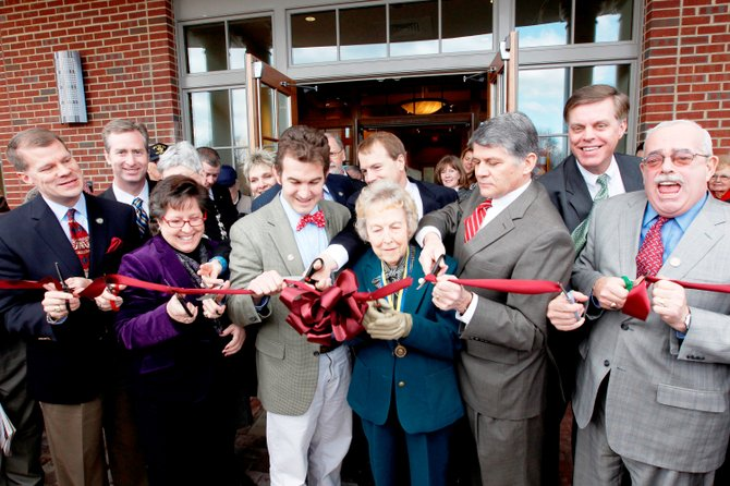 Geraldine Sherwood was surrounded by dignitaries during the ribbon-cutting ceremony at the grand opening celebration of the Stacy C. Sherwood Center in February 2011.