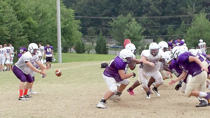 The Lake Braddock offense works during practice.