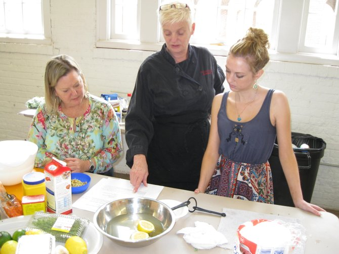 (From left): Terry Holman, chef Kathleen Linton and Catherine Boyd, all of Lorton, discuss Old Bay tofu fishcakes.