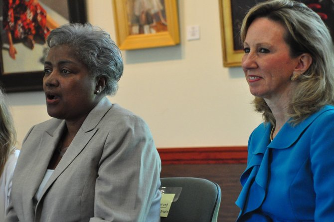 From left, Donna Brazile and Del. Barbara Comstock (R-34) speak to young women at the Great Falls Library Tuesday, Aug. 13. Brazile, who was the first African American woman to manage a presidential campaign with Al Gore in 2000, spoke to the women about pursuing their dreams.