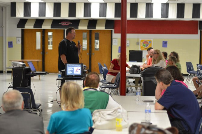 Parents listen to speakers at Herndon High Coaches' Night at the school cafeteria.