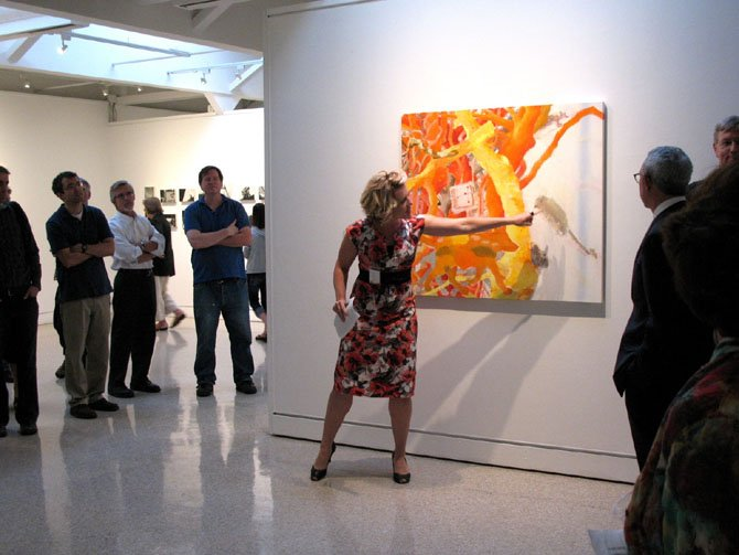 Beatrice Gralton talks about a painting at an exhibition opening at MPA.