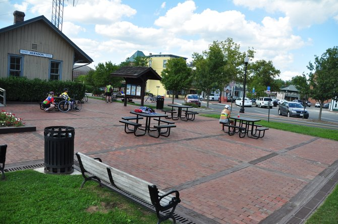 New picnic tables are just one of several improvements in downtown Herndon designed to make the area friendlier for cyclists and other visitors.