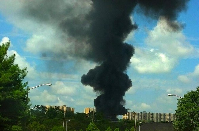 Heavy plumes of thick black smoke can be seen for miles.