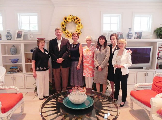 "From left: Mildred ""Millie"" Thompson, Woman's Club president; Supervisor John Foust (D- Dranesville), Honorary Tour Host Admiral Kathleen L. Martin, Mrs. Albert Rosecan and Dr. Karen Kierce, owners of homes on the 2013 Holiday Homes Tour; Woman's Club Homes Tour Co-Chairmen Rosemarie Lazo and Jane Studabaker."
