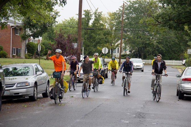 The TC crew bikes through the neighborhood where 