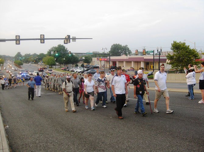 The Ft. Belvoir Fife and Drum Corps leads a contingent of soldiers, civic leaders and community participants across the bridge during the 12th annual Springfield Bridge Walk on Aug. 27.