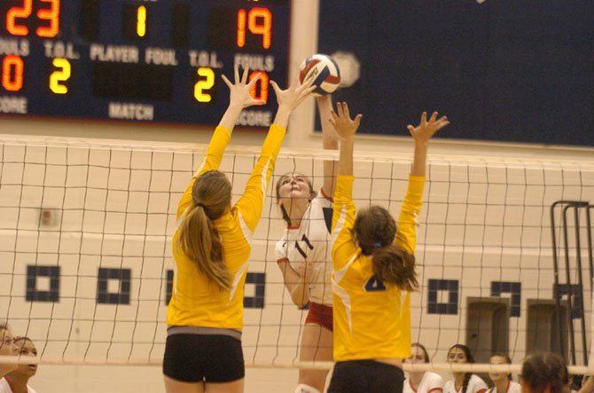 Woodson senior Eliza Fisher (11) finished with 31 kills against Robinson on Sept. 3.