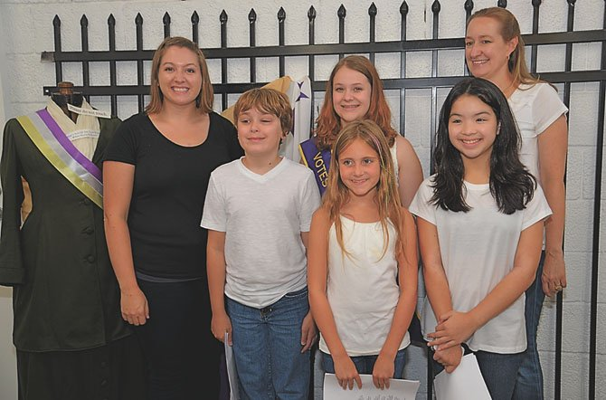 From left, back row—Abby Smith with the Metropolitan Academy of the Arts, Sam Sharrett, and Colleen Buck. Front row—Ryan Buck, Anya Jones and Amy Cooper. Sharrett, Ryan Buck, Jones and Cooper, all students at the academy located within the Workhouse Arts Center campus, performed suffragist songs for the celebration.