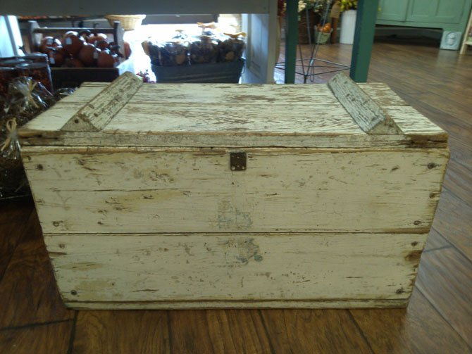 Storage is important in small spaces. Vintage boxes and crates corral clutter and add character. For example, this vintage white box is small and attractive, but the lid provides concealed storage inside.