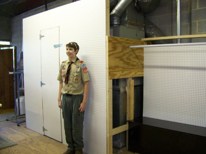 Austin David Nicholls of Oak Hill with the display area space he built for Pender's ReGift Thrift Store as part of his Eagle Project.
