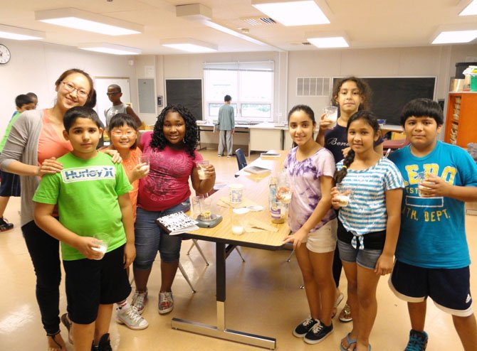 Teacher Lucia Park and some of the rising fifth- and sixth-graders who learned about estimation and measurement while making parfaits.