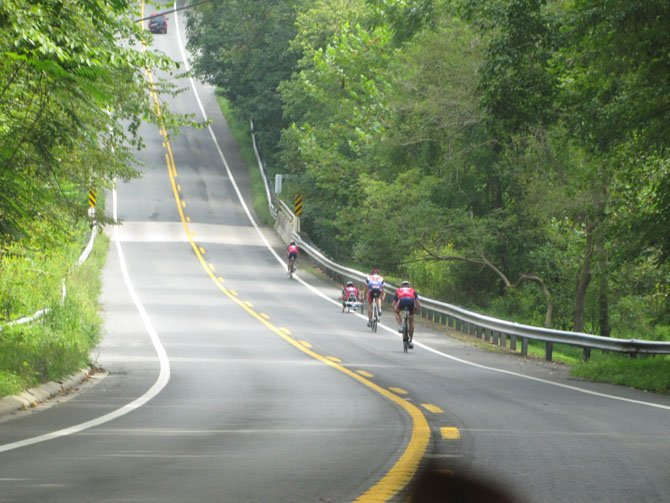 Veterans, including who have lost limbs, use adaptive bikes to tackle steep hills on River Road and were clocked going more than 45 miles per hour, as part of a Walter Reed program, Ride 2 Recovery.