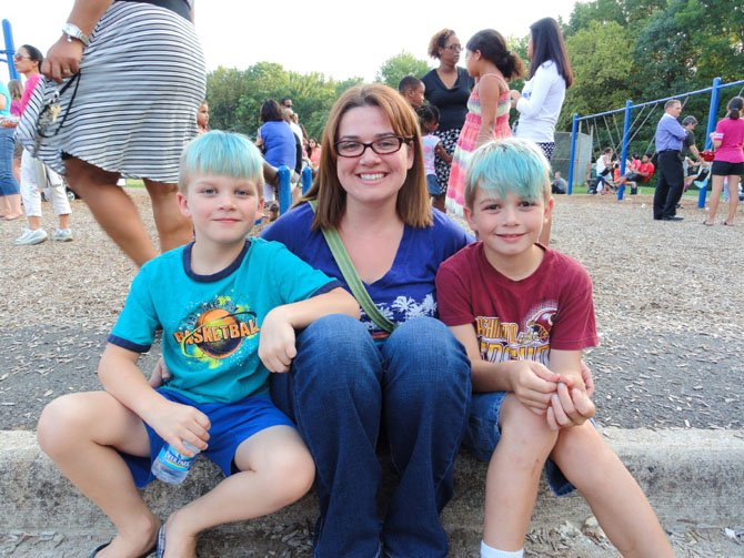 Enjoying London Towne Elementary's picnic are mom Emily Horning and sons (from left) William, 7, and Dimitri, 9.