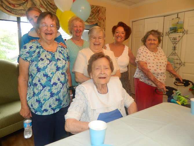 Evelyn Wood, center, celebrates her 100th birthday with Bea Higgins, Higgins' granddaughter Olivia, Beanie Lambert, Skippy Lacey, Betty Whitefoot and Joy Reed.