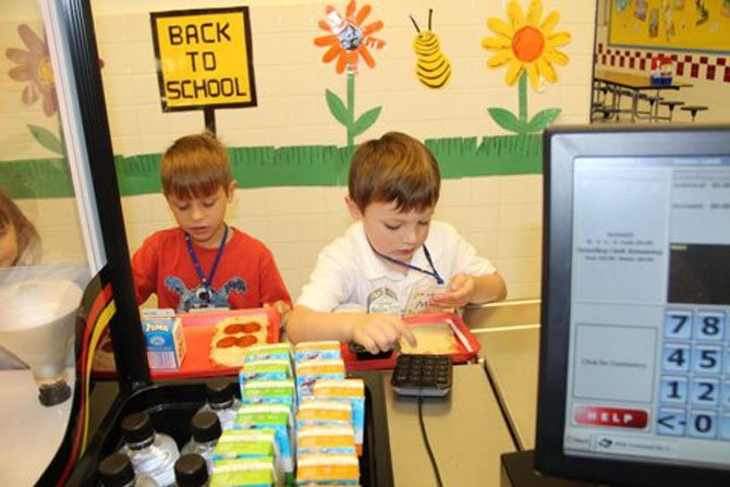 Even though it was only the first week of school, Churchill Road kindergarteners Billy Center and Max Brooke were already experts at entering their PIN to pay for lunch.
