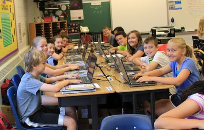 Chrissy Frantz's sixth grade class completed log-in procedures on their new laptops. Pictured clockwise from left are: Andrew Curtis, Kelly Walton, Mark Hamilton, Camille Borja, Mariano Olsen Fappiano, Shalomi Nimesh, Zane Kidwell, Megan Li, Ian, Palk, Lexi Peters, Sam Wellborn and Katherine Walker.