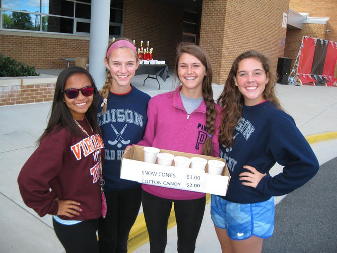 Edison High field hockey team members (from left): Robyn Palompo, Emily Jarmin, Danielle Hook and Natalie Hartzell sell sno-cones and cotton candy for their fundraiser.
