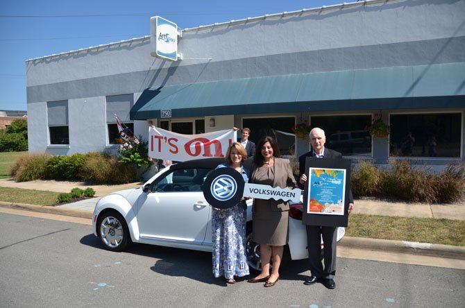 Mayor Lisa Merkel (left) stands with the Director of State Government Relations for Volkswagen Group of America Nicole Barranco, and President of the Herndon Foundation for the Cultural Arts Harlon Reece.
