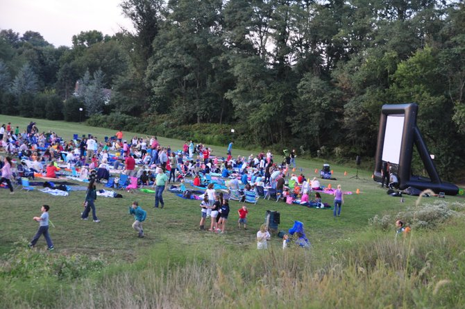 Families gather behind Colvin Run Elementary School Friday, Sept. 20 for their annual outdoor movie night.