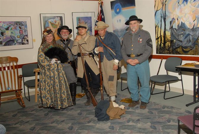 Civil War reenactors (from left) Debbie Turner as Pauline Mosby; Rick Turner as John S. Mosby; Addison Speer as a Civil War private; his father, Harvey Speer, as a confederate soldier; and Ray Borden as a Confederate Infantry Color Sergeant.