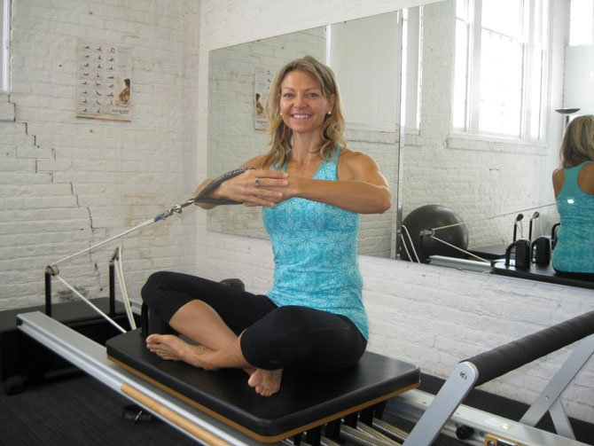 Art of Movement Program Director Lesley Spalding practices side twist pilates at the Workhouse Arts Center.