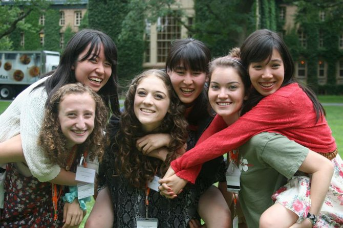 Maddy Naide (far left) with her roommate, Ayaka, on her back, as well as other roommate pairs enjoying free time on the Princeton Campus.