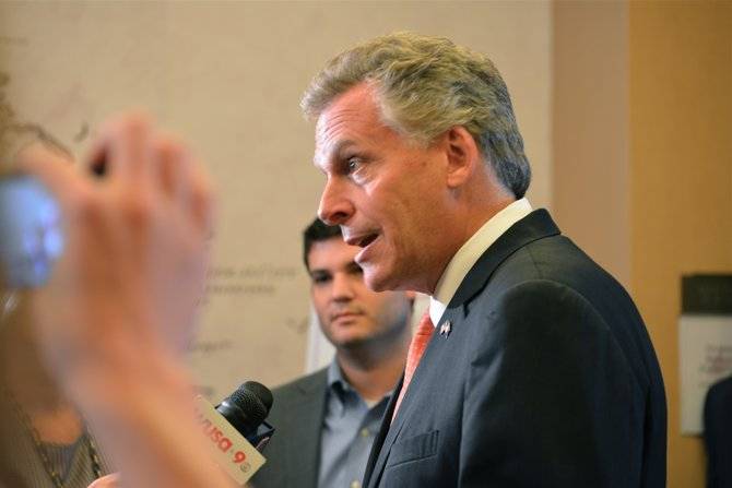 Terry McAuliffe takes questions from the press after his keynote speech at the 2013 VASBP Summit.