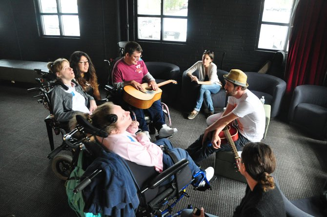 Singer-songwriter Todd Wright speaks to members of the Specially Adapted Resource Club at the Old Firehouse Teen Center Friday, Sept. 27.