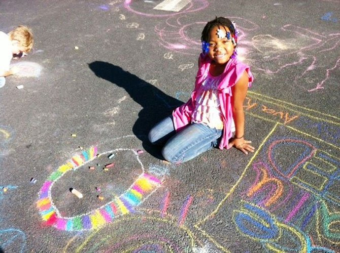 Jade draws during Chalk for Peace day at Lake Anne Elementary School Monday, Sept. 23.