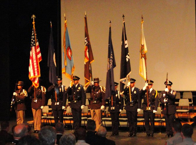 The Fairfax County Honor Guard presents the colors at the Criminal Justice Academy graduation.
