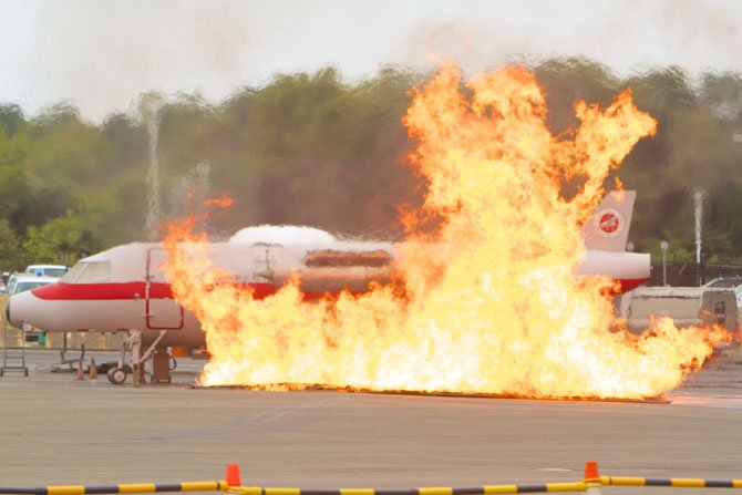 During the full scale emergency preparedness exercise at Reagan National Airport on Sept. 21, the fire is ignited on a training plane. The controlled fire is propane fed.