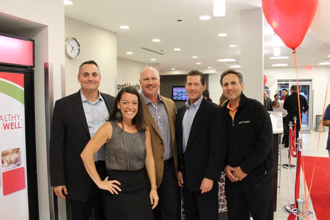 From left, Brian Smith, Mindy Pierce, Mark Fisher, Mitch Batkin and Glenn Rappaport of Sport & Health Clubs celebrate the new renovation at their Reston location Thursday, Sept. 26.