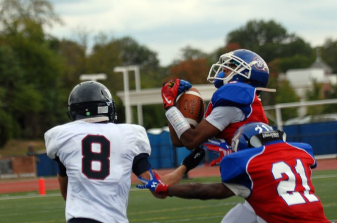 T.C. Williams defensive back Timmy Rattanaphone intercepted three passes against Woodson on Sept. 28.