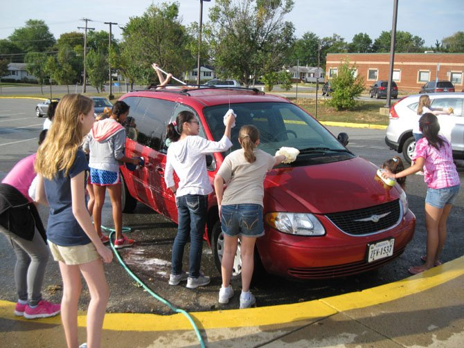 About 70 seventh- and eighth-graders took part in a car wash at Mark Twain Middle School along Franconia Road in a fund-raiser for the school band on Saturday, Sept. 21. The funds will be used to buy instruments and uniforms for the school.