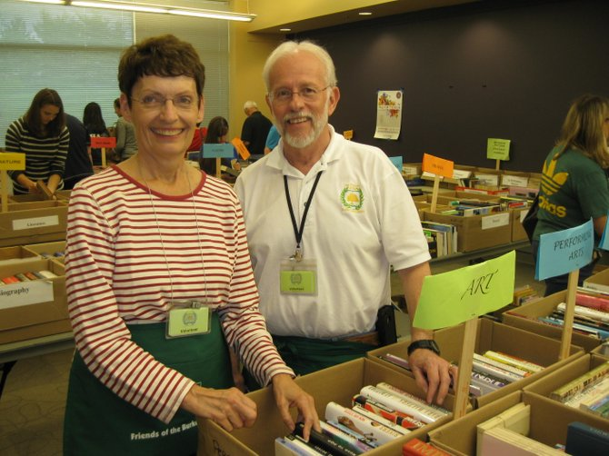 Book sale chairman Joy Whittington and Brian Engler of the Friends of the Burke Centre Library on Freds Oak Road.