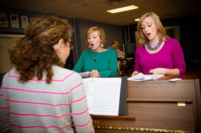 Rehearsal pianist and vocal coach Elisa Rosman working on music with (from left to right) Jaclyn Young and Maureen Rohn.