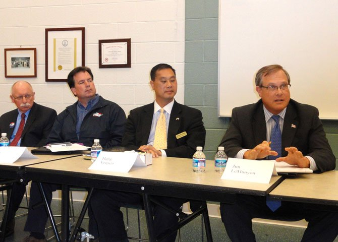 From left: Jerry Foltz, Tim Hugo and Hung Nguyen listen while Jim LeMunyon answers a question.