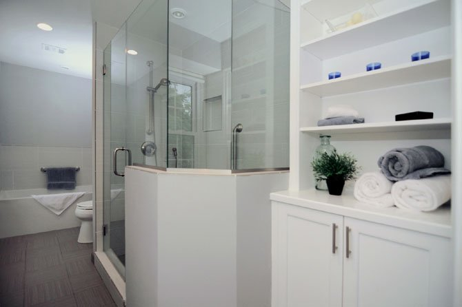Designer Allie Mann added a frameless glass shower and extra storage space when she remodeled the master bathroom of this Alexandria home.