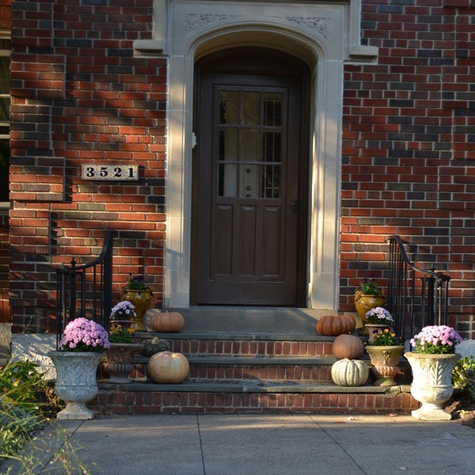 Mums and pumpkins are classic fall accessories for both the exterior and interior of one's home.